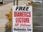 Scientology recruitment sign - Free Dianetics Lecture, All Welcome, Wednesay 7 pm